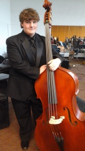 Jon Featheringill standing with his String Bass