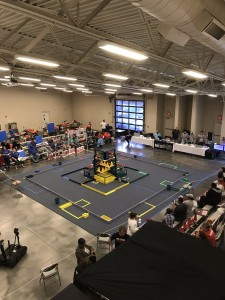 Overview of the BEST Robotics Competition Area with observers in the stands