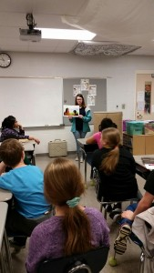 High School student reading to a group of Elementary Students