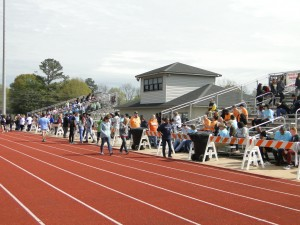 Crowd in the bleachers at the track field