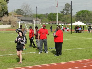Adult sponsors on the track field