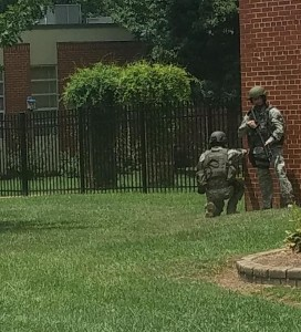 Armed first responders outside of a school